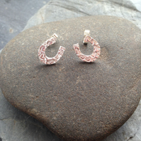 Horse shoe silver studs with heart impressions