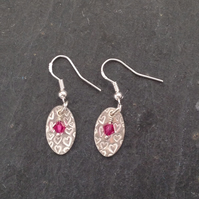 Fine silver oval earrings with fuchsia pink crystal