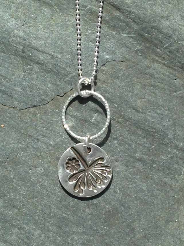 Dandelion and flower pendant set on a silver hoop