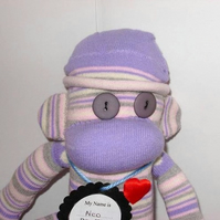 Neo the lilac sock monkey