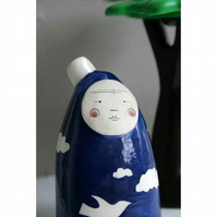 Moon face bottle sculpture - blue skies, white clouds, white dove