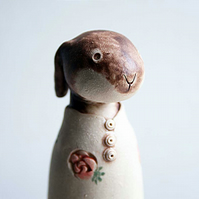 Whimsical rosebud hare sculpture