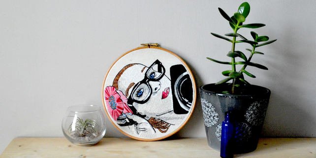 Hoop art girl with glasses and camera