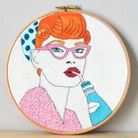 Embroidery hoop art, vintage retro lady with pink glasses, with bottle and straw