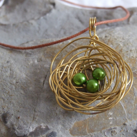 Brass Nest Pendant: A cute birds nest pendant made from brass wire and beads