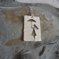 Pendant Girl with Umbrella: silver pendant of a girl holding her umbrella
