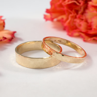Gold Wedding Bands: A Set of his and hers 14k textured gold wedding rings