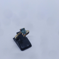 Teal emerald cut moissanite and gold ring. Size MN