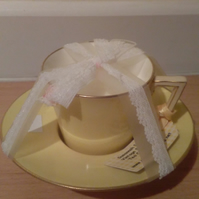Yellow teacup candle with soya wax