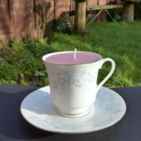 Recycled honeysuckle candle in a tea cup