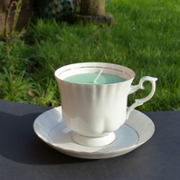 Green honeysuckle scented candle in a tea cup