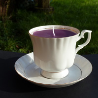 Plum coloured jasmine scented candle in a tea cup