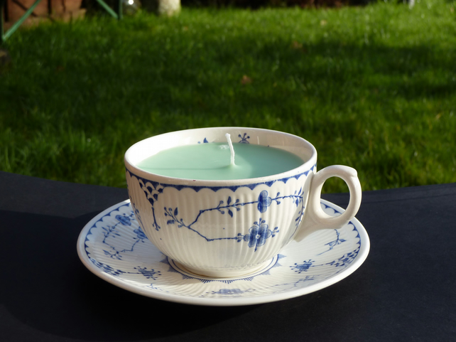 Meadow green honeysuckle scented candle in a tea cup