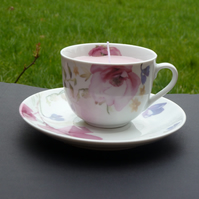 Floral scented candle in floral teacup