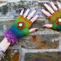 Fingerless gloves. Crochet gloves. Wrist warmers. Eye catching and pretty.