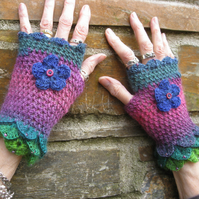 Gloves. Fingerless gloves.  Wrist warmers. Eye catching and pretty.