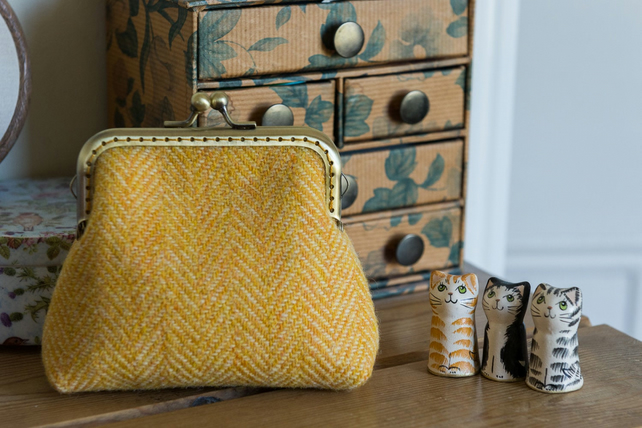 Frame purse made with buttery yellow Harris Tweed and Liberty lawn lining