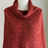 This cape is a super soft and warm capelet or poncho, hand knit and seamless