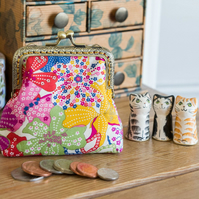 Coin purse made with colourful Mauvey print Liberty Lawn and golden lining