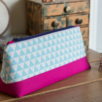 Zip pouch in blue flags print in a really useful size, perfect as a make up bag