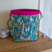 Reversible drawstring project bag made with tiger and leopard prints