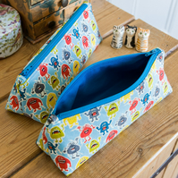 Zip pouch made with colourful fun monsters print in a really useful size,