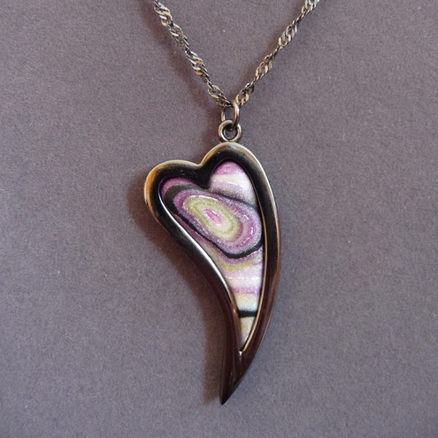Polymer clay heart pendant in pearlescent green/purple