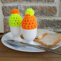 Egg cosies,orange, yellow, handmade crochet egg cosies with pom-poms,house gift