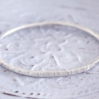 Sterling Silver Cross Hammered Narrow Bangle at MidasTouch Jewels
