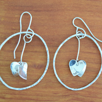 Sterling Silver Hammered Hoop Earrings with double heart drop by MidasTouch Jewe