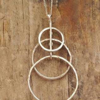 Silver triple rings pendant from MidasTouch Jewels by Patsy in Wales