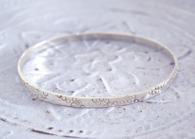 Sterling Silver Hammered Circles Narrow Bangle at MidasTouch Jewels by Patsy in