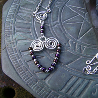 Silver plated wire and toho bead spiral heart pendant necklace