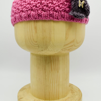 "Hand Knitted ""Daisy"" Head band in pink with a mauve flower"