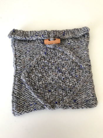 Hand knitted aran design pouch in grey and blue