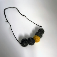 Felted bead necklace in ochre and grey wool