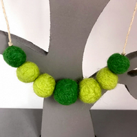 Felted bead necklace in shades of green wool