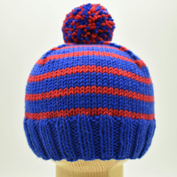 Hand knitted baby hat in blue and red stripes