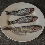 Sardine trio on plate textile artwork