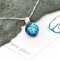 Light blue round glass pendant on a sterling silver necklace