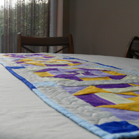 Yellow, Purple and blue pinwheel Quilted table runner