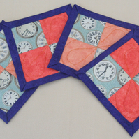 Set of Four Coral and blue quilted drinks coasters featuring vintage clocks