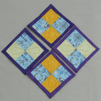 Set of Four Seaside theme yellow and purple quilted coasters