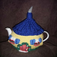 Fairy Door Tea Cosy Knitting Pattern uses Double Knit yarn for 3 sizes of cosy