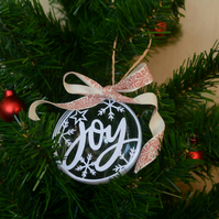 Christmas bauble with 'joy' papercut, snowflake pattern