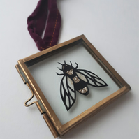 Tiny Bee Papercut in glass hanging frame