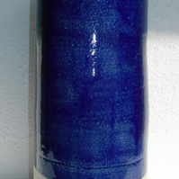 Tall elegant indigo blue Vase with Pout.