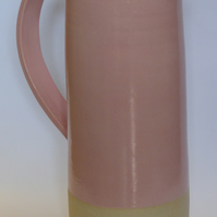 Wheel thrown Pink tall stoneware jug.
