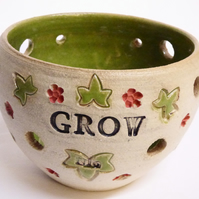 "Tea light holder Wheel thrown ""Grow"" green."