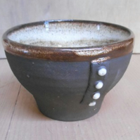 Tea Bowl, black clay, white glaze.